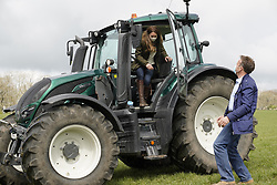 Farmer Stewart Chapman laughs as the Duchess of Cambridge steps from a tractor during a visit to Manor Farm in Little Stainton, Durham. Picture date: Tuesday April 27, 2021.