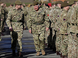The Prince of Wales (centre), Colonel Welsh Guards, presents campaign medals to soldiers from the 1st Battalion Welsh Guards at Elizabeth Barracks, Pirbright Camp in Woking, following their return from Afghanistan.