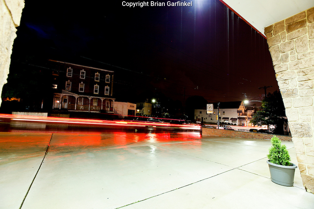 Cars drive down Baltimore Pike in Clifton Heights Pennsylvania