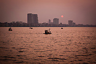 People ride swan pedaloes on West Lake at dusk in Hanoi, Vietnam, Asia