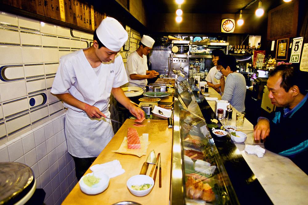Sushi bar at breakfast time at Tsukiji Fish Market (Tokyo Central Wholesale Market), Tokyo, Japan