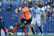 Chris O'Grady, Brighton striker and Chris Taylor, Blackburn Rovers midfielder during the Sky Bet Championship match between Blackburn Rovers and Brighton and Hove Albion at Ewood Park, Blackburn, England on 21 March 2015.