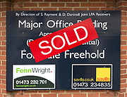 Close up of Sold estate agent sign for major office building commercial property,  Ipswich, Suffolk, England, UK