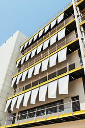 Building with sun shading blinds at Institute of Science and Technology at Masdar City in Abu Dhabi United Arab Emirates UAE