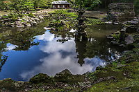 Tamazato Garden is officially known as Gardens of Tamazato Residence.  Naroiki Shimadzu built the villa called Tamazato Residence here in 1835 - the original villa was much larger than what is left today, as most of the structure was burnt down during two wars. Today only the gardens, a tea house and the gate remain.The upper garden has an ornamental pond that can be viewed from the residence teahouse room. The lower garden is circuit style allowing people to enjoy the view from any point around the garden. Tamazato Garden was created at the end of the Edo period, when strolling/landscape gardens were in fashion. Altogether, the whole garden is made up of the of the Shoin-Tei Inner Garden and the Kaiyushiki Teien back garden beside the tea ceremony room.  Elements include large stones, bridges and walkways are set around the pond as its center. Altogether there are nine stone lanterns of various shapes and sizes.  Although stone lanterns are almost always present in a Japanese garden, usually there is not this much variety. Tamazato Garden was designated as a national scenic beauty site by the Japanese government in July, 2007.