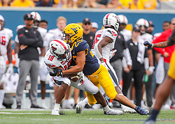 Oct 2, 2021; Morgantown, West Virginia, USA; Texas Tech Red Raiders wide receiver Myles Price (18) catches a pass and is tackled by West Virginia Mountaineers safety Sean Mahone (29) during the first quarter at Mountaineer Field at Milan Puskar Stadium. Mandatory Credit: Ben Queen-USA TODAY Sports