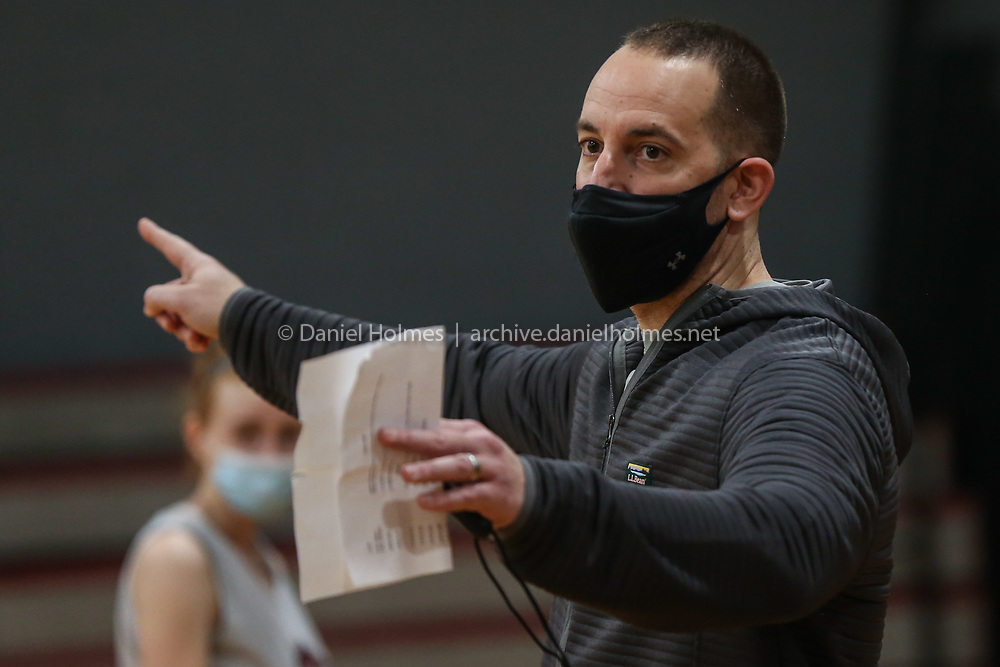 Millis coach Dave Fallon speaks with his players during girls varsity basketball practice at Millis High School on Jan. 02, 2021.