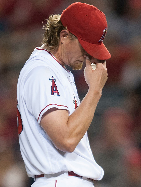 The Angels' Jered Weaver reacts after giving up a home-run to the Twins' Byron Buxton in the sixth inning Monday at Angel Stadium. Weaver gave up six runs (five earned) on eight hits in six innings of work.<br /> <br /> ///ADDITIONAL INFO:   <br /> <br /> angels.0614.kjs  ---  Photo by KEVIN SULLIVAN / Orange County Register  -- 6/13/16<br /> <br /> The Los Angeles Angels take on the Minnesota Twins Monday at Angel Stadium.