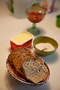 Ottersland Dahl family, of Gjettum, Norway (outside Oslo). Fresh baked bread for family by Gunhild Valle Ottersland, 45. Model-Released.