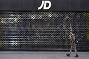 Shuttersare down at JD Sports in Oxford Street shopping district as Londoners await the imminent end of the second coronavirus national lockdown before the capital enters tier two in the new three tier system on 1st December 2020 in London, United Kingdom. Non essential shops will be allowed to reopen as of 2nd December while in other areas of the country, controversially, they will have to remain closed.