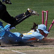 Amita Sharma is run out from a throw by Sophie Devine as keeper Rachel Priest celebrates during the match between New Zealand and India in the Super 6 stage of the ICC Women's World Cup Cricket tournament at North Sydney  Oval, Sydney, Australia on March 17, 2009. Photo Tim Clayton