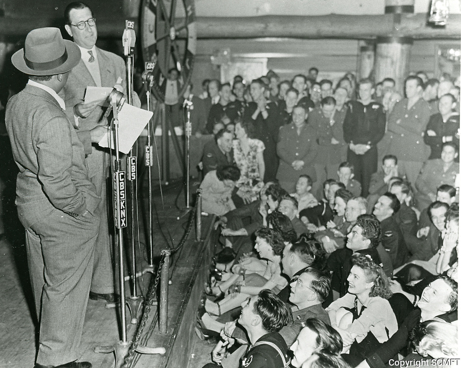 """1944 Eddie """"Rochester"""" Anderson and Arthur Treacher during a radio broadcast at the Hollywood Canteen."""