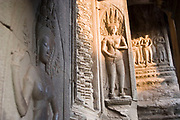 Balusters and intricate carving reliefs of Apsara dancers at Angkor Wat. This jewel in the crown of Angkor's ancient temples is a vision of beauty, might and Khmer architectural excellence. The five towers dominate the view, which you are led to trough outer walls, along causeways over the moat and past the two giant pools which act as a mirror of the vision. Consecrated at around 1150 to the Hindu god, Vishnu it is suggested that construction took 30 years.