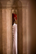 A turbaned guard looks through a column at the City Palace, Jaipur, India<br /> The City Palace is a complex of palaces in central Jaipur built between 1729 and 1731 by Jai Singh II, the ruler of Amber