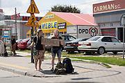 Young couple hitchhiking to Katowice Poland. Warsaw Poland