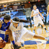 020415  Adron Gardner/Independent<br /> <br /> Hopi Bruin Jennaya Day (12), left, and Window Rock Scout Autumn Powell (11) tangle for a loose ball at the Fighting Scout Event Center in Fort Defiance Wednesday.