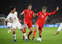 Denmark's Thomas Delaney (left) takes on Wales' Joe Allen (centre) and Wales' David Brooks