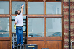 A man cleaning windows.