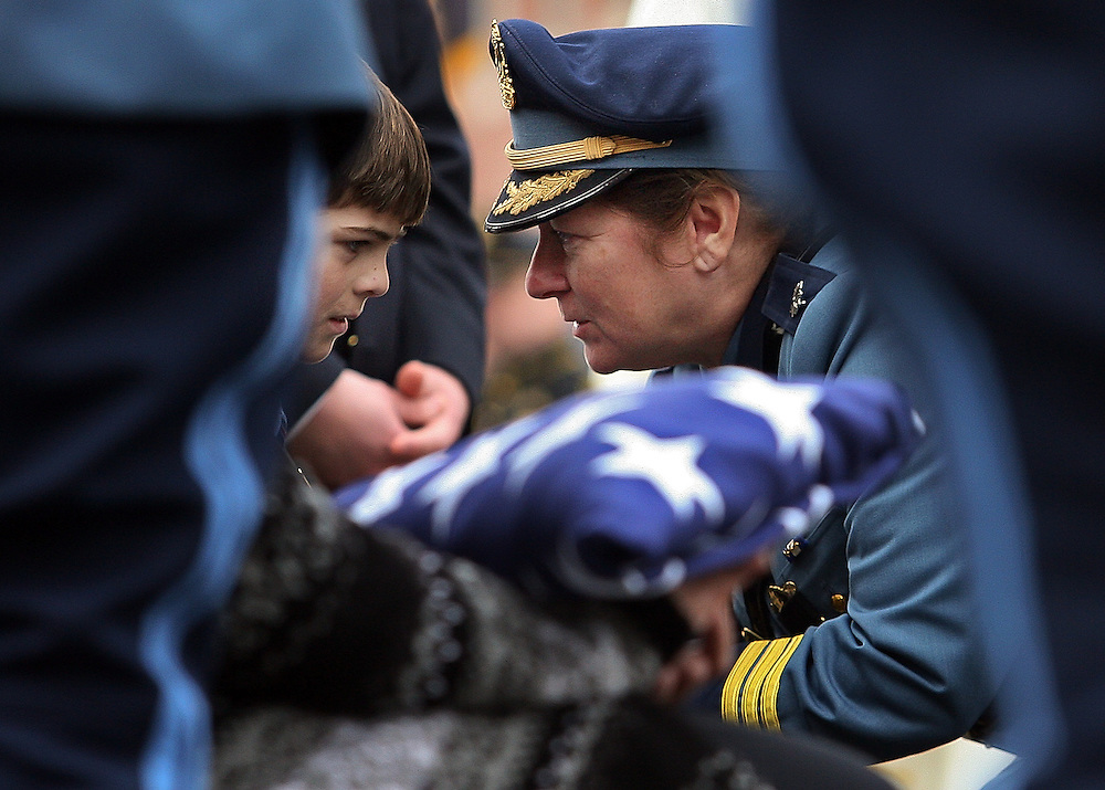 (020209 Bradford, MA)  A State Trooper gives a gift to Matthew Cashin during the funeral for Massachusetts State Trooper Richard J. Cashin at Sacred Hearts Church.