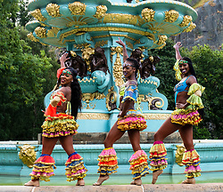 Edinburgh, Scotland, UK; 1 August, 2018. Caribbean Dynasty dance troupe perform at photocall beside Ross Fountain in Princes Street Gardens as part of the Edinburgh Fringe Festival