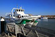 Passenger ferry boat Catamaran Bahia service arriving at Puerto de Santa de Maria, Cadiz province, Spain