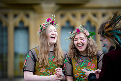 © Licensed to London News Pictures. 01/05/2017. Oxford, UK. Two young women in pagan dress, laughing during celebrations for May Day in the early hours of the morning near Magdalen Bridge in Oxford, Oxfordshire . Students and members of the public were again prevented from jumping from the bridge in tot he water, which has historically been a tradition, due to injuries at a previous years event . Photo credit: Ben Cawthra/LNP