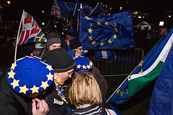London, UK. 13th March, 2019. Anti-Brexit activists from SODEM (Stand of Defiance European Movement) standing outside the Houses of Parliament watch and listen to proceedings inside as MPs vote on a 'No Deal' Brexit.