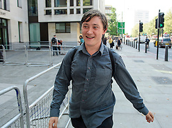 © London News Pictures. 14/09/2016. London, UK. ALEX ECHART leaves Westminster Magistrates Court in London where he was one of nine Black Lives Matter campaigners who pleaded guilty to charges relating to a protest at London City Airport on September 6, in which the protest group locked themselves together on the airport's runway.  Photo credit: Ben Cawthra/LNP