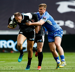 Cory Allen of Ospreys under pressure from Jarryd Sage of Dragons<br /> <br /> Photographer Simon King/Replay Images<br /> <br /> Guinness PRO14 Round 18 - Ospreys v Dragons - Saturday 23rd March 2019 - Liberty Stadium - Swansea<br /> <br /> World Copyright © Replay Images . All rights reserved. info@replayimages.co.uk - http://replayimages.co.uk