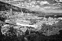 Black and white view of Monte Carlo, the Port of Hercules, and the Mediterranean Sea taken from the Princes Palace, Monaco France.