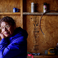 Martina One Star recounts her time at the Standing Rock Sioux camp as she helps prepare for a prayer ceremony at the home Elouise Brown in Littlewater Thursday.