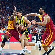 Galatasaray's Joshua Ian SHIPP (R) and Fenerbahce's Roko Leni UKIC (C) during their Turkish Basketball league Play Off Final fourth leg match Galatasaray between Fenerbahce Ulker at the Abdi Ipekci Arena in Istanbul Turkey on Saturday 11 June 2011. Photo by TURKPIX