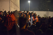 Nov. 16, 2015 - Wegscheid, Bavaria, Germany - GERMANY, Bavaria, Wegscheid; <br /> <br /> Slovenian officials checking people in the crowd and trying to make the situation more orderly as migrants get impatient waiting to cross over from the processing camp here and into Austria.<br /> ©Exclusivepix Media