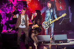 © Licensed to London News Pictures . 01/07/2017 . Manchester , UK . Bez (Mark Berry) , Rowetta Idah and Peter Hook . Hacienda Classical play at the Castlefield Bowl as part of Sounds of the City , during the Manchester International Festival . A collaboration between DJs Mike Pickering and Graeme Park and the Manchester Camerata orchestra , Hacienda Classical reworks music by bands including the Happy Mondays and New Order and features Manchester musicians including Rowetta and Peter Hook . Photo credit : Joel Goodman/LNP