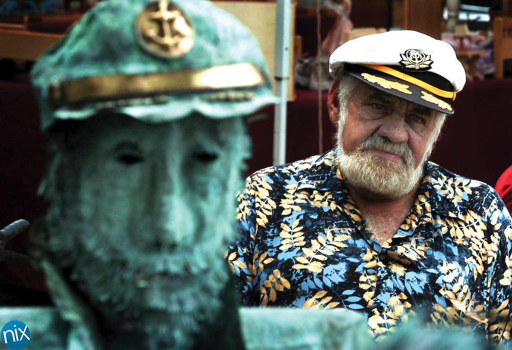 Capt. Larry Whidden, a sculptor from Florida, at his tent at the St. Simons Island Sunshine Festival.