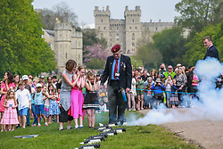 Windsor, UK. 22nd April 2019. John Matthews, borough bombardier, supervises children in firing a small cannon as part of a traditional 21-gun salute on the Long Walk in front of Windsor Castle for the Queen's 93rd birthday. The Queen's official birthday is celebrated on 11th June.