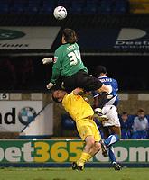 Photo: Ashley Pickering.<br />Ipswich Town v Preston North End. Coca Cola Championship. 17/10/2006.<br />Ipswich's Lewis Price make a heavy challenge on Preston's Brett Ormerod