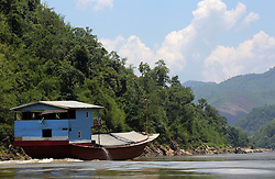 Cargo river boats on the River Mekong in the early morning.  Pak Beng, Oudomxay Province, Lao PDR