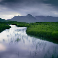 Rannoch moor, Highlands, Scotland.<br /> <br /> I could probably spend the rest of my photographic life on Rannoch moor and not even scratch the surface of photographic possibilities, I love the the brooding prehistoric atmosphere of the moor, and was trying to pin down even a scrap of these emotions with this shot. (Next to one of  the sluggish 'canals'' feeding into Loch nah Stainge ..while being constantly eaten by the ravenous midge... )