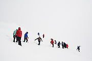 """Members of the University of Washington Climbing Club attend """"Snow School"""" at Paradise in Mount Rainier National Park, Washington, under the direction of club president Brian Polagye. At the annual club event, members practice essential skills like glacier crevasse rescue and self arrest."""