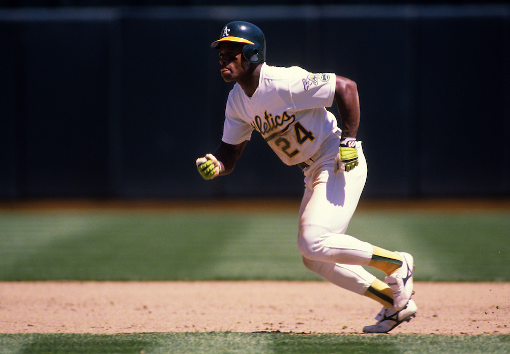 OAKLAND, CA-UNDATED:  Hall of Famer Ricky Henderson of the Oakland Athletics runs the bases at the Oakland Coliseum.    (Photo by Ron Vesely)