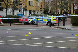 **Please note the deceased concerned in this fatal collision was a pedestrian, not a cyclist as previously reported**<br /> © Licensed to London News Pictures. 30/01/2020. London, UK. Evidence markers at the crime scene on Peckham Road as police investigate a fatal road traffic collision in Southwark. Police were called at 06:26hrs on Thursday, 30 January to reports of a VW Golf car in collision with a pedestrian. The pedestrian was pronounced dead at the scene shortly after the collision. Police have arrested one man at the scene on suspicion of causing death by dangerous driving and failing a roadside drug test. Photo credit: Dinendra Haria/LNP