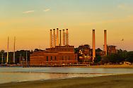 Sun sets on Glenwood Landing Power Plant, on Hempstead Harbor of Long Island's North Shore. Seen from North Hempstead Beach Park, Roslyn, New York U.S. 29th June 2013.