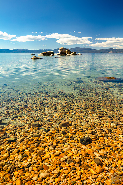 """""""Pebbles at Whale Beach 4"""" - These pebbles were photographed along the shore of Whale Beach on the East shore of Lake Tahoe. Whale Rock can be seen in the distance."""