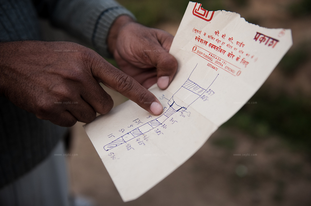 A farmer at village Khunimajra, some 25km form Chandigarh, showing a plan drafted for digging a deep tubewell in his field. The ground water in this village is more that 600ft deep. Farmers in punjab are facing problems of depleting levels of underground water levels that in some places is as deep as 700ft. They complain that the state government does not supply enough electricity to use the pumps. They only receive 3-5hr of electricity per day and have to use diesel generators to pump the water for their fields.