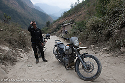 Corey Froschheuser wonders what he just encountered on day-4 of our Himalayan Heroes adventure riding from Pokhara to Kalopani, Nepal. Friday, November 9, 2018. Photography ©2018 Michael Lichter.