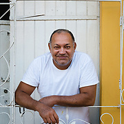Portrait of Cuban man smoking in doorway