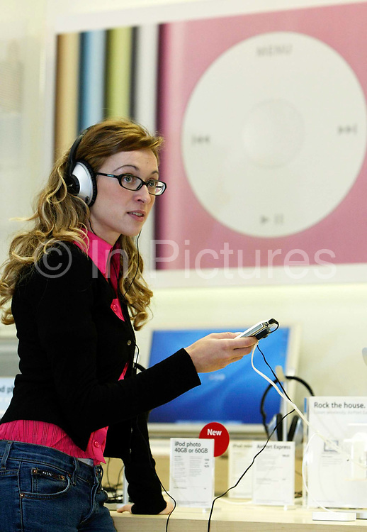 Lourdes Salcedo tests an ipod at the Apple Store on Regent Street, London. This is Apple's flagship store in the UK. At the time this was the first such store in Europe, the others being in the United States and Japan.