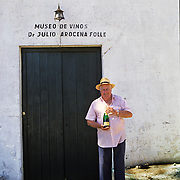 South America, Uruguay; Florida, A vintner proudly displays his creation.