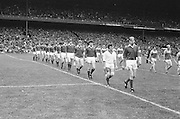 Wexford and Cork teams line out onto the pitch before the All Ireland Senior Hurling Final, Cork v Wexford in Croke Park on the 5th September 1976. Cork 2-21, Wexford 4-11.